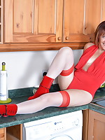 Naughty British housewife playing in the kitchen