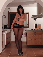 Sexy babe is topless and wrapped in black pantyhose | PantyhoseDiva.com