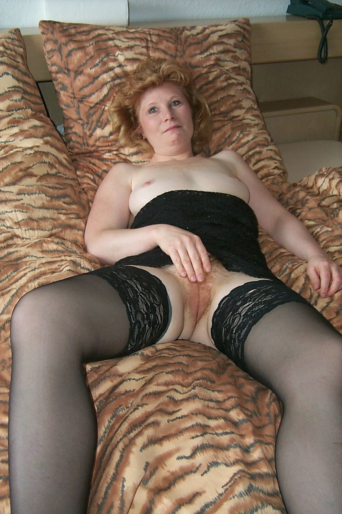 image Soccer mom in stockings shows big tits and wet pussy